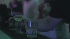 Barman serving tequila and juice to guests at night club Stock Footage