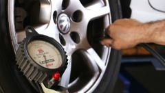 Car repair tire wheel pressure test Stock Footage