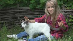 Happy Little Girl Petting Cat in Yard, Children Playing Kitten, Pets, Animals - stock footage