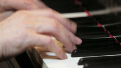 Hands playing music at the piano: Stock Footage