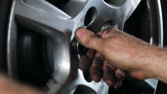 Car repair mounting wheel Stock Footage