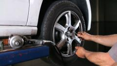 Car repair changing tires Stock Footage