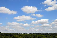 Sky with cumulus clouds - stock photo