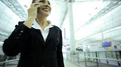 Stock Video Footage of Caucasian European Businesswoman Airport Global Travel Smart Phone Communication