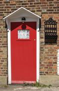 Red Cottage door. Shoreham.UK - stock photo