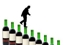 Wine bottles and alcoholic man Stock Photos