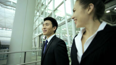 Airport Departure Hall Business Finance Asian Chinese Caucasian Colleagues Stock Footage