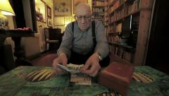 old man is counting his little money: poor, lonely, fright, want, need, poverty - stock footage