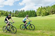 Stock Photo of Sport happy couple riding bicycles in coutryside