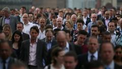 Huge Crowd Of Rush Hour Commuters Flood Down A Busy City Street In Slow Motion Stock Footage