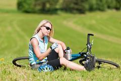 Sport mountain biking girl relax in meadows Stock Photos