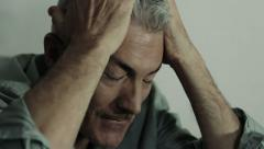 desperate man crying: depression, sadness, loneliness, upset, alone - stock footage