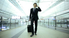Asian Chinese Businessman Airport Travel Destination Smart Phone Stock Footage