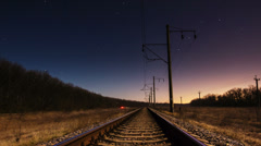 4K. Timelapse of a starry sky and rail track in the foreground Stock Footage