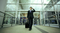 Asian Chinese Businessman Airport Global Travel Smart Phone Communication - stock footage