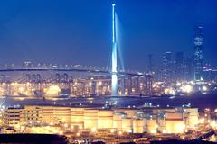 Gas container and bridge at night Stock Photos