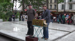 Musicians playing with vintage barrel organ and singing in Sunday market,Paris Stock Footage