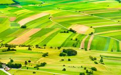 Aerial view of green fields and slopes Stock Photos