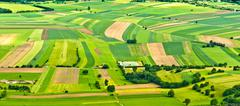 aerial view of green fields and slopes - stock photo
