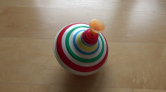 Rotating   vintage humming-top whirligig children toy - stock footage