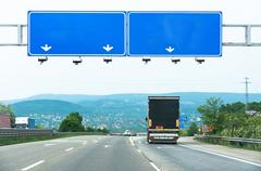 Road signs with truck - stock photo