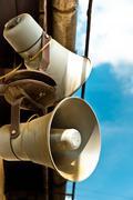 Loudspeakers against blue sky - stock photo