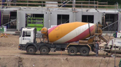 Concrete cement mixer truck lorry machine in building work place Stock Footage