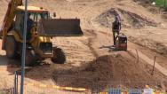 Stock Video Footage of street road work place with excavator digger and worker