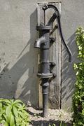 Old water pump - stock photo