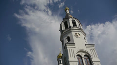 Stock video footage panorama of the beautiful church with clouds Stock Footage