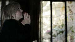 woman's intense prayer with crossed hands: religion, faith, devotion, Catholics - stock footage