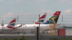 Airplane tail fins at Heathrow Airport, UK. - stock footage