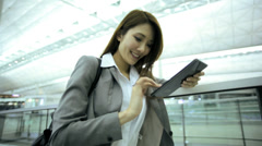 Asian Chinese Businesswoman Airport Global Travel Mini Tablet Communication - stock footage