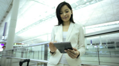 Asian Chinese Businesswoman Airport Global Travel Tablet Communication - stock footage