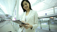 Asian Chinese Businesswoman Airport Global Travel Tablet Communication Stock Footage
