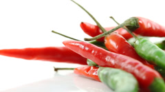 Stock Video Footage of Red and Green Chillies on White Background