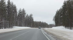 Winter driving, following the vehicle in northern part in Russia Stock Footage