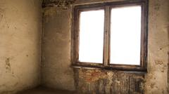 Abandoned room with dirty walls, dusty floor and damaged window Stock Photos