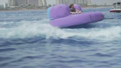 Collection Group of friends enjoying tubing attraction on the water Stock Footage