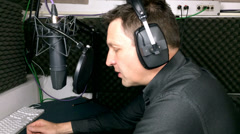 Voiceover artist in studio voice booth Stock Footage