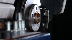 Car repair mount wheel inserting screws 2 Stock Footage