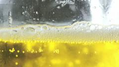 Pouring beer in a glass close up footage: lager beer, yellow, light, bubbles Stock Footage
