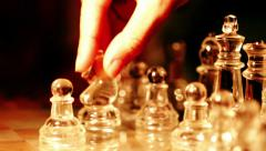 close up of glass chess playing: finger, moves, chessboard, moving, girl - stock footage