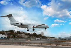 Airplane landing in St. Maarten Island, Dutch Antilles - stock photo