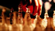 Stock Video Footage of girl playing with glass chess moving pawn: moves, chessboard,