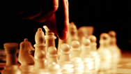 Stock Video Footage of close up of glass chess playing: moves, chessboard, moving pawn, warm light