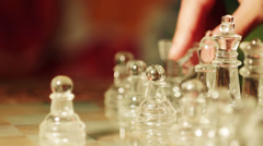 close up of glass chess playing: move, knight, chessboard, - stock footage