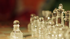 close up of glass chess playing: moving knight on the chessboard - stock footage