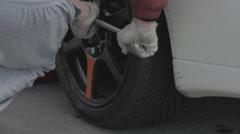Race car repair - tire service Stock Footage