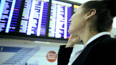Stock Video Footage of Caucasian Businesswoman Airport Global Travel Smart Phone Communication